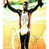 Carl Lewis Signed A4 Sheet of The Olympic Champion
